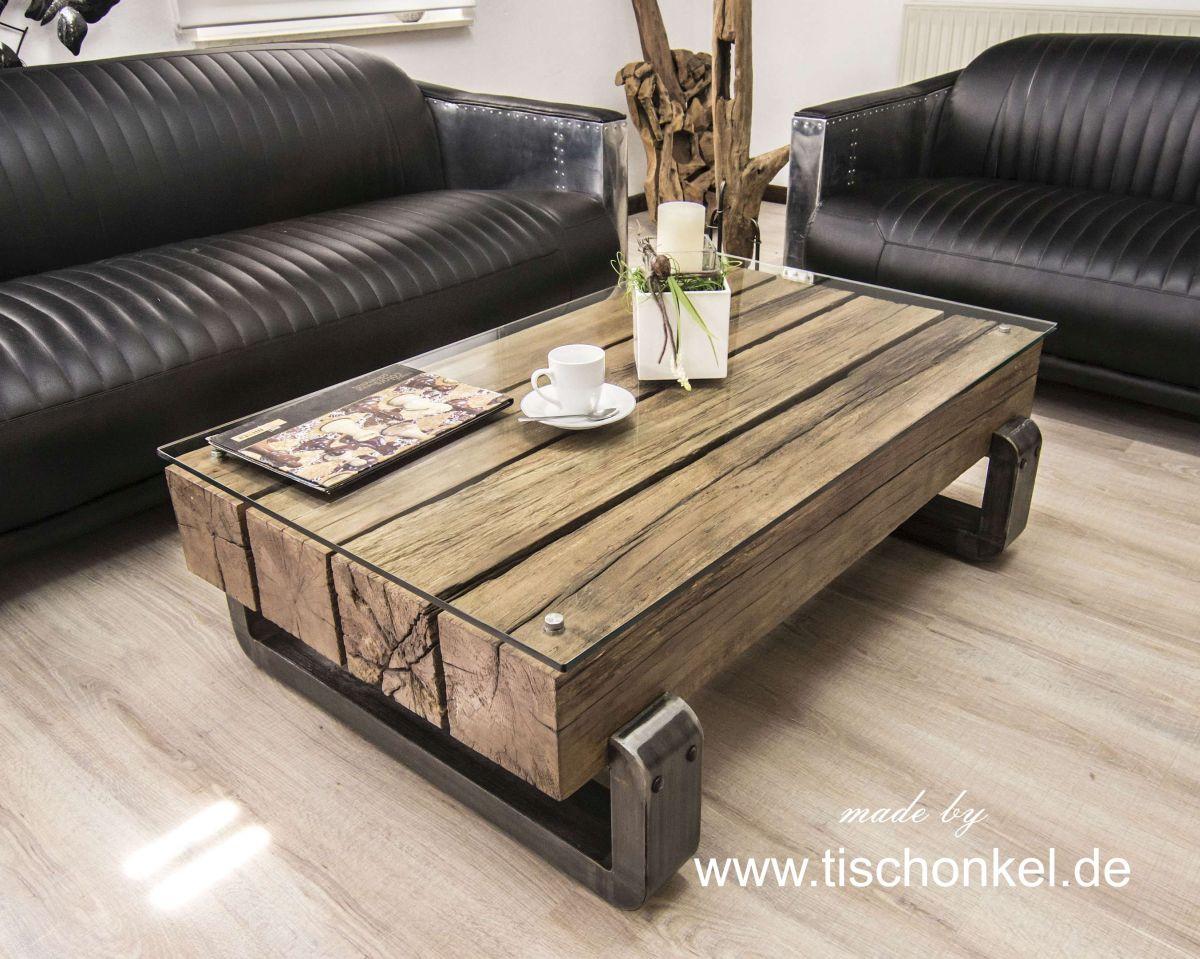 Aussergewöhnlicher Couchtisch Blocks Aus Massiven Holzbohlen Mit Einem  Tischgestell Aus Rohstahl