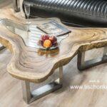 Couchtisch Clash mit Glasscheibe und einem Tischgestell aus gebürstetem Edelstahl aussergewöhnliches Design