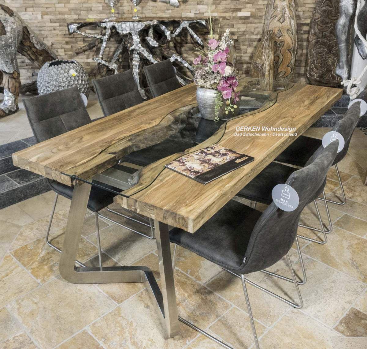 Design Esstisch der Serie Elements aus Holz mit einem Tischgestell aus Edelstahl   Der Tischonkel